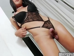 Busty thai tgirl Ploy shows off her body and starts jerking