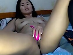 Scrumptious Korean is playing with a pink dildo in bill of an obstacle webcam