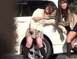 Asian teen exposes panties outdoors