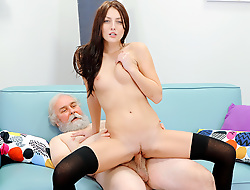 Tireless brunette babe rides an old dick in a about-face cowgirl position without taking off her high-heeled shoes and black stockings