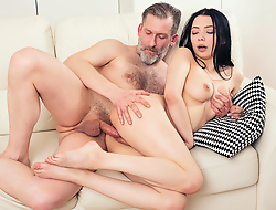 Experienced but still strong man thrusts his dick deep into a fresh throat and pussy of his younger brunette girlfriend from behind.