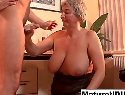 Mature BBW takes a load on her huge natural boobs