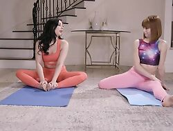 Two comely yoga babes make reverence on the floor