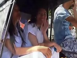 Two crestfallen Filipina nurses give special care to lucky male tourist