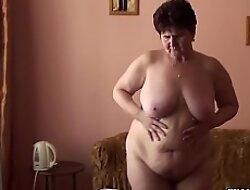 Granny here big tits displays her body
